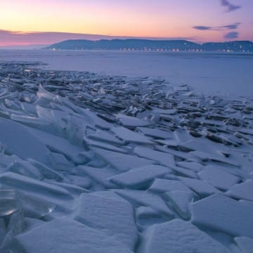 52068372 - winter landscape with frozen lake balaton and sunset sky in hungary